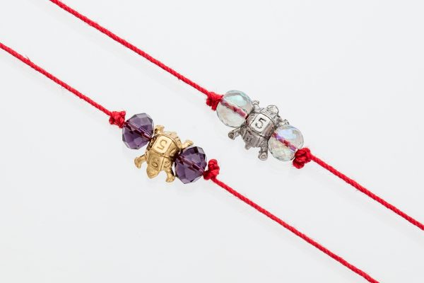 Turtle Red thread with 2 gemstones